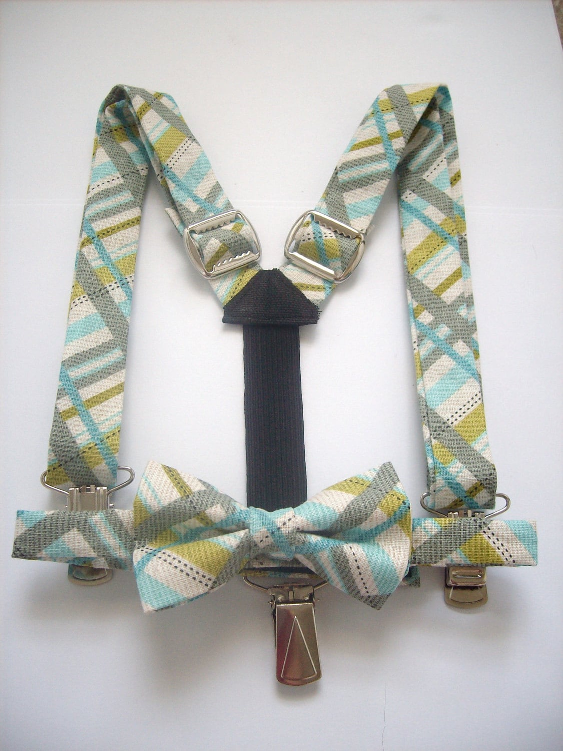 boy suspenders and bow tie