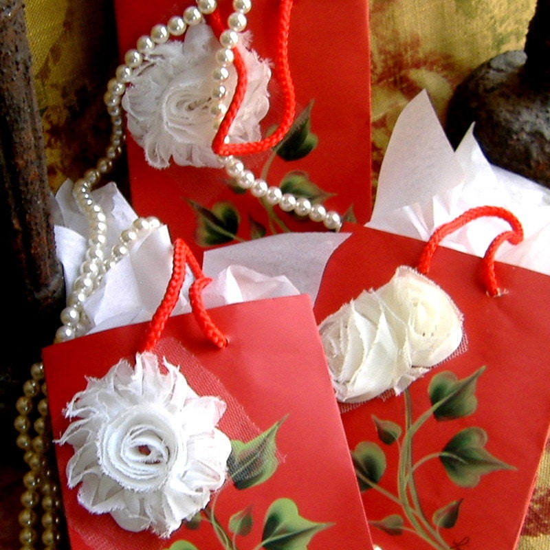 Red Gift Bags with White Fabric Flowers and Handpainted Leaves