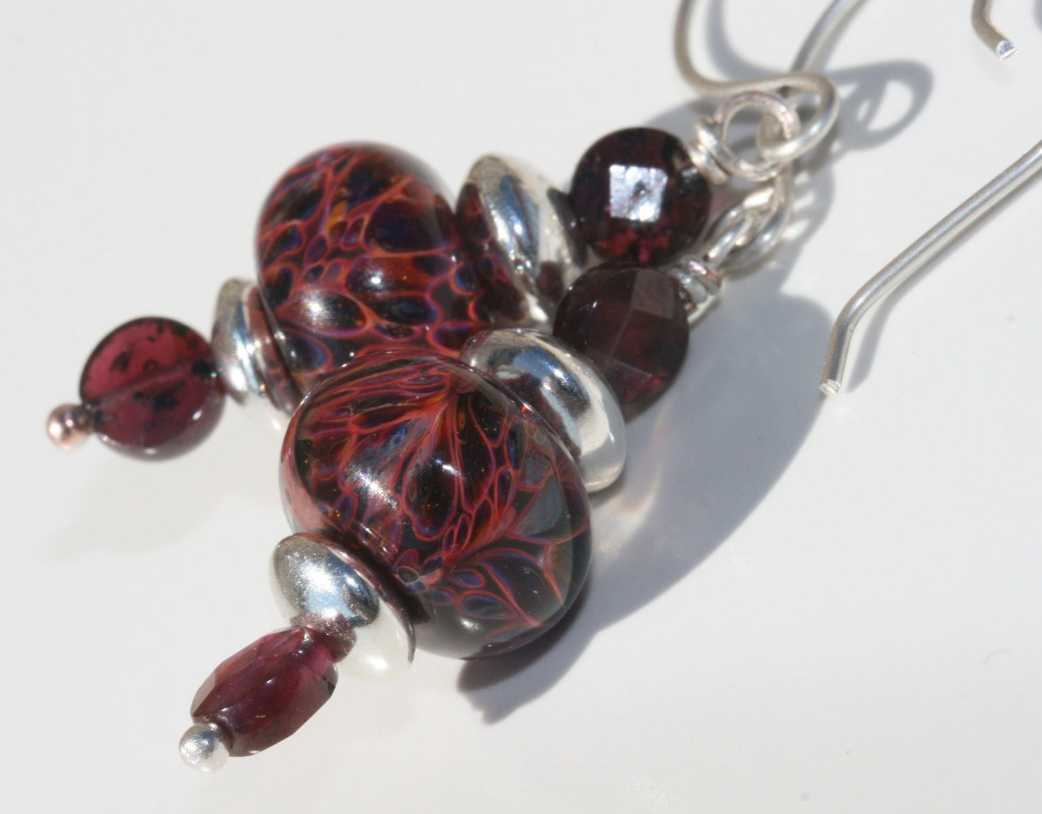 Deep red artisan lampwork earrings with garnet and hand forged sterling silver