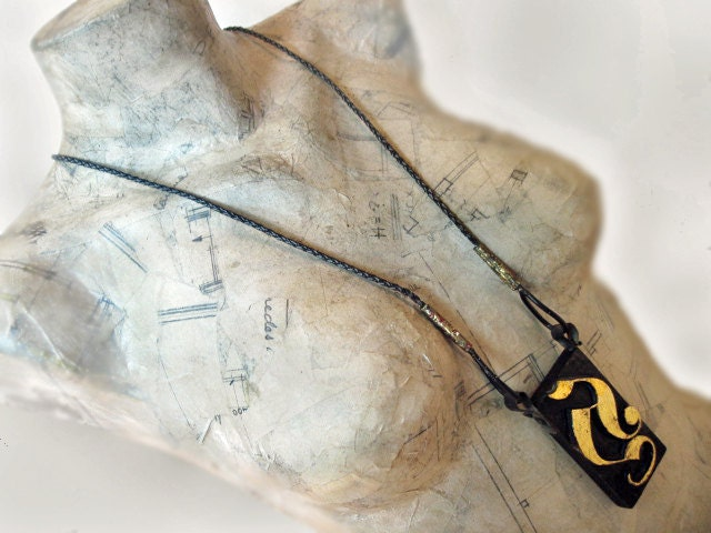 A for Aberash. Woodblock Print Long Black Necklace with gold leaf.