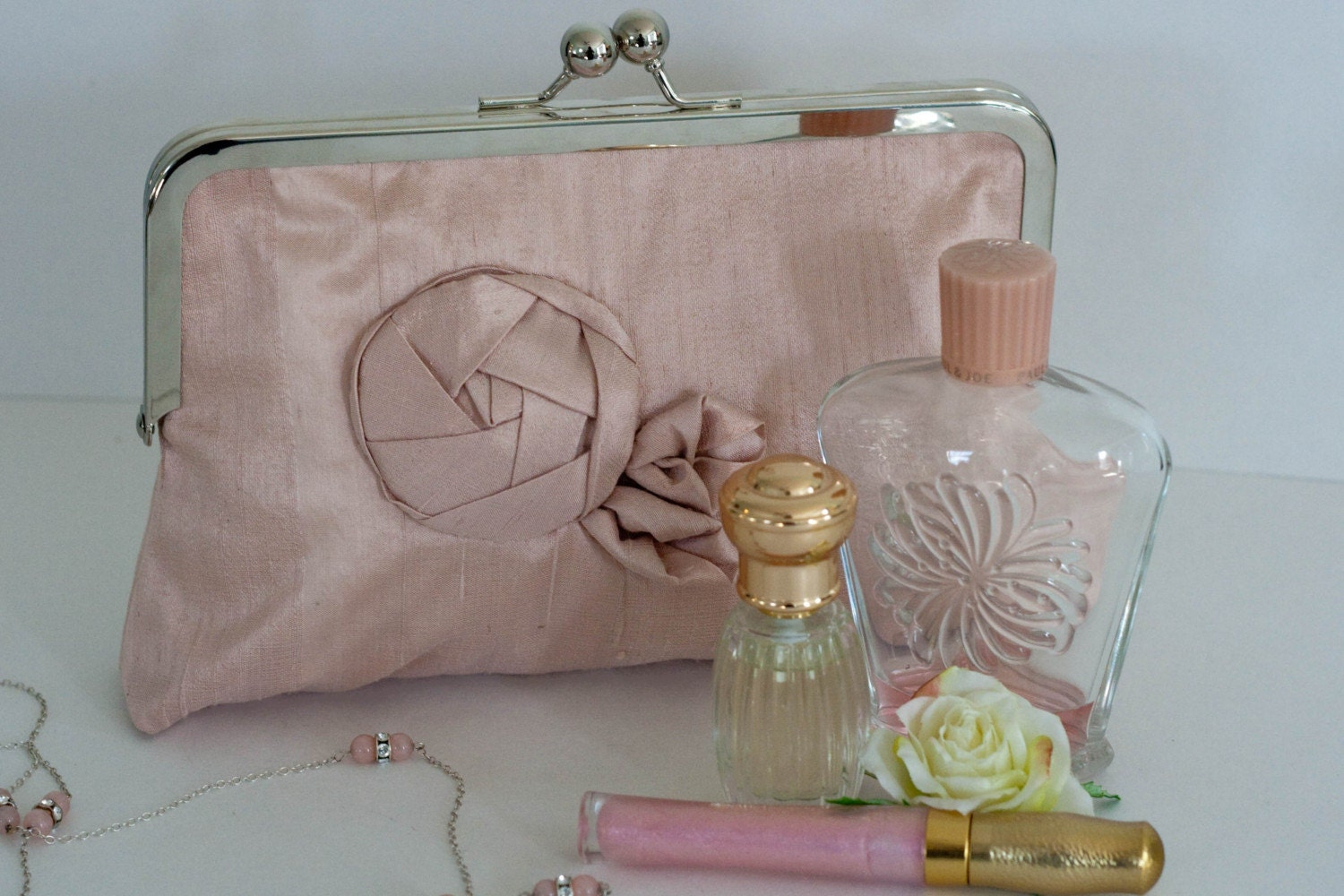 Chloe blush silk origami clutch