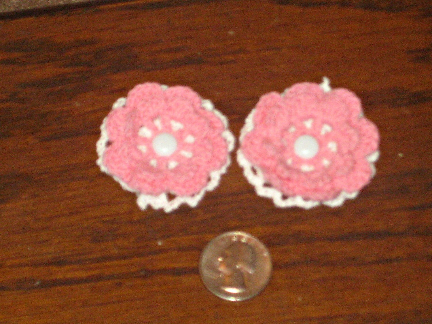 pink and white crocheted flower hair clips