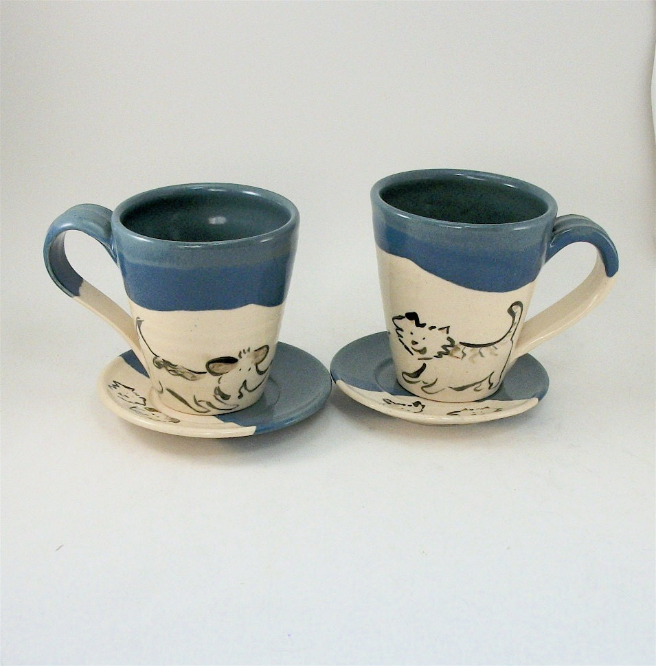 pair of dog and cat cups and saucers