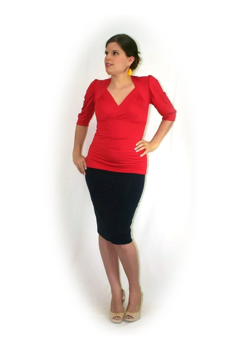 Catalog photo of a rose top and black skirt