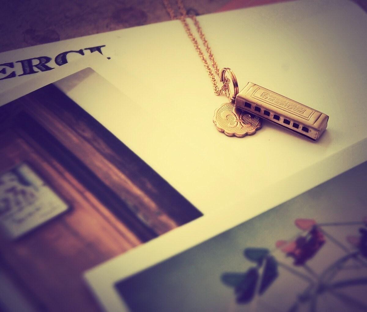 harmonica fleur  .  a petite charm  necklace   .