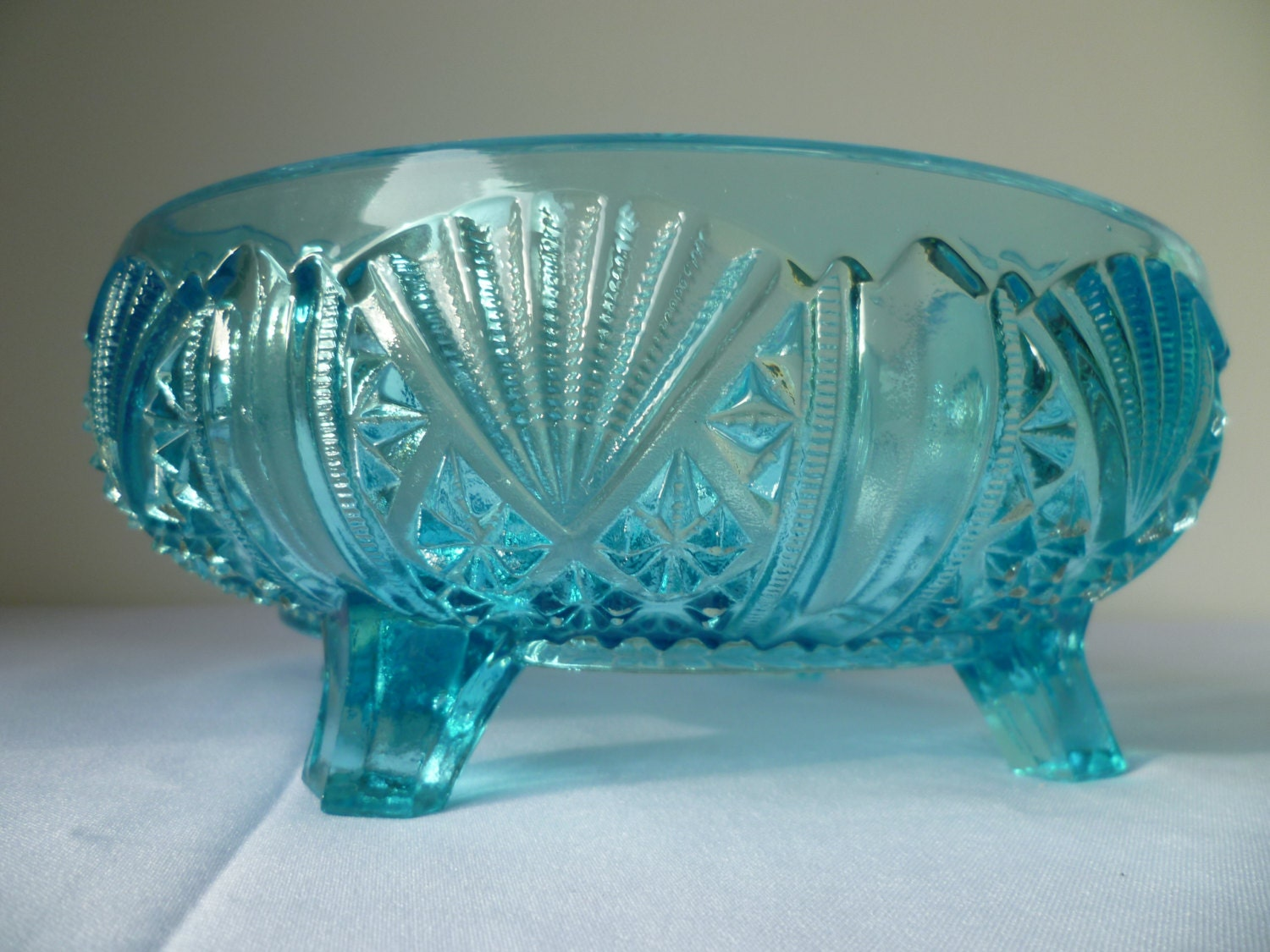 A 1920 1930 Large  Blue  Glass Bowl Decorated in Art Deco style Relief .