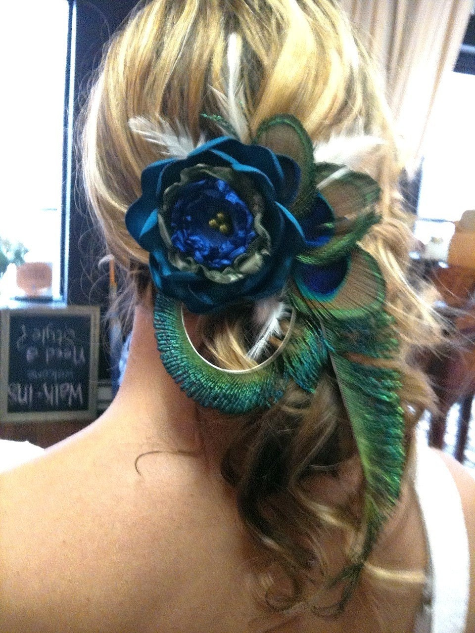 Beautiful Peacock hair clip with large flower.