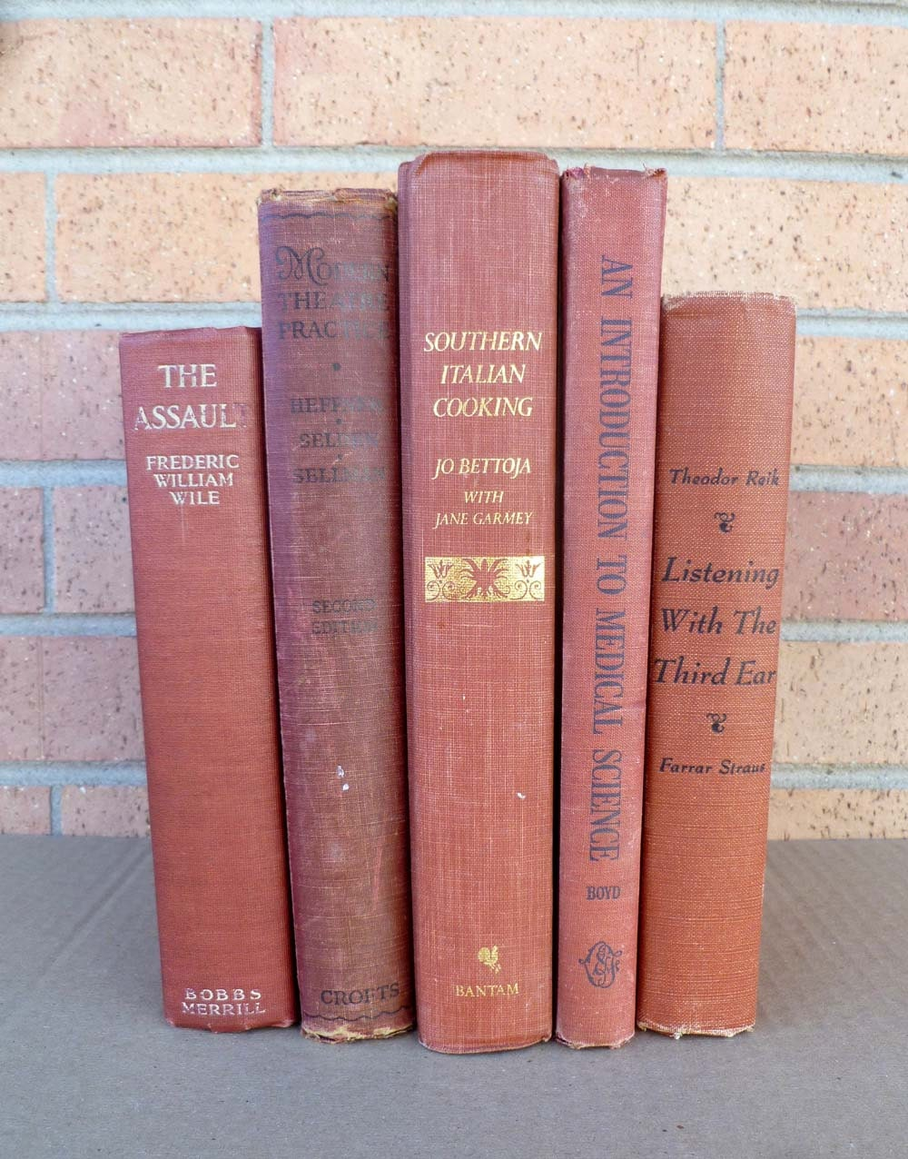 Vintage book collection in shades of paprika cinnamon nutmeg five old books - FreeParking