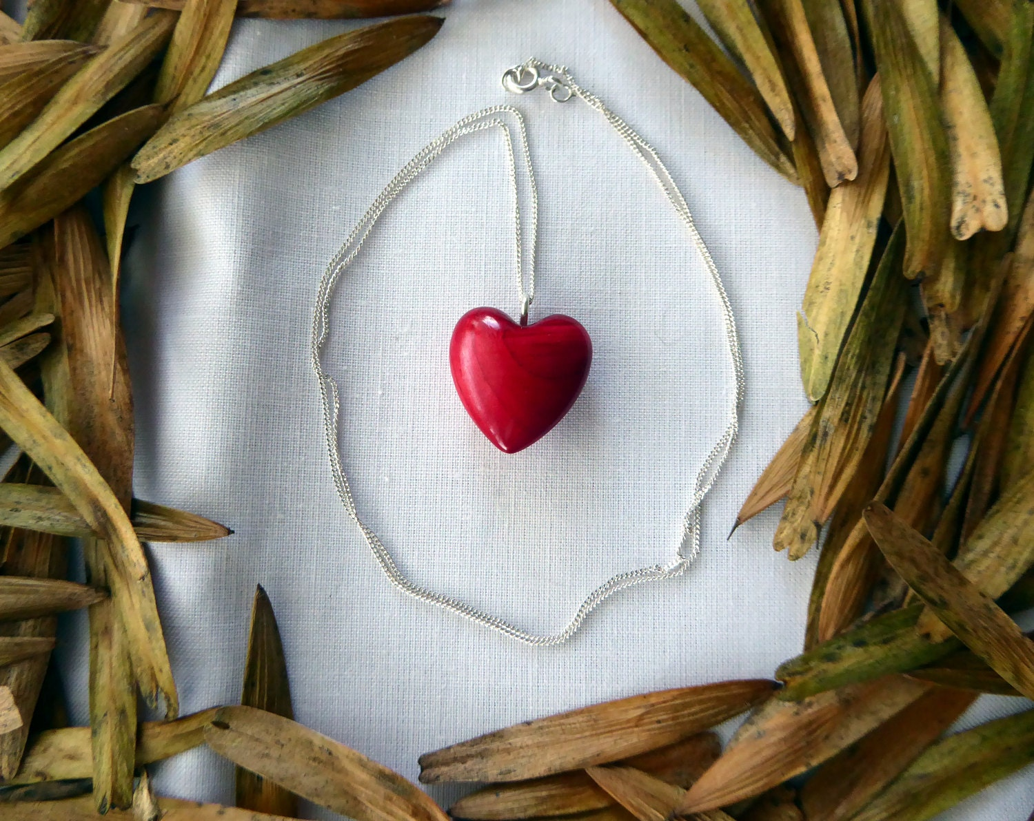 Red dyed cypress wood heart pendant necklace on sterling silver chain