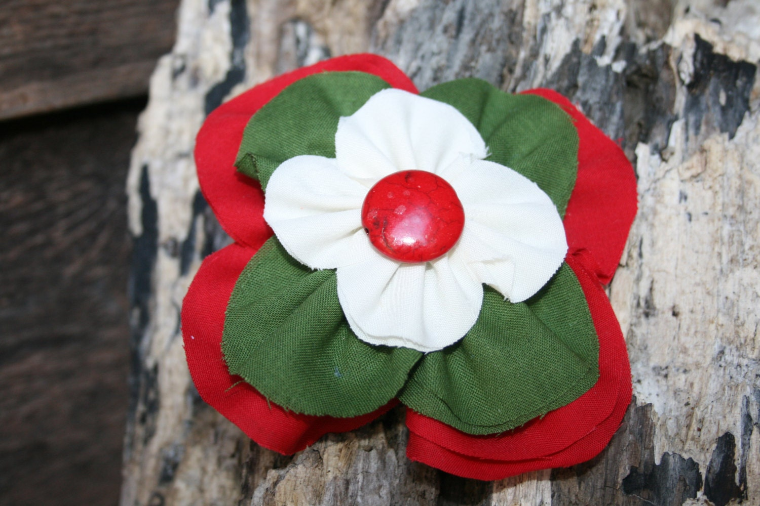 Handmade red, green and cream stacked flower with red button in the middle. - RockabillyBabyPlace