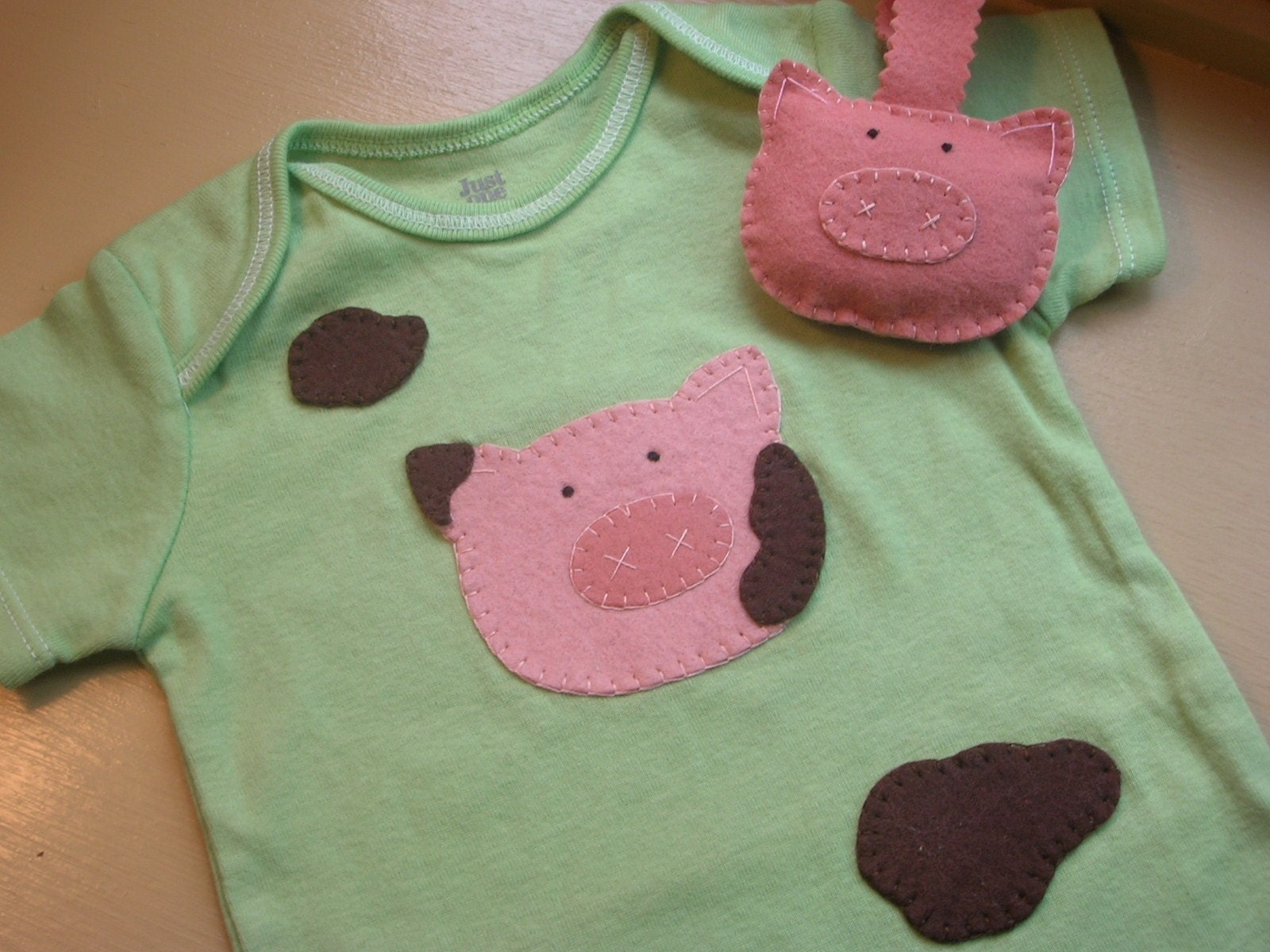 Muddy Piggy onesie and pacifier holder
