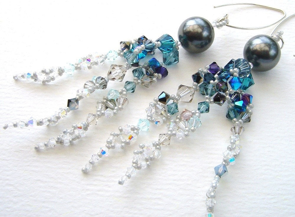 Super-sparkly earrings like dangling icicles in blue, metallic and crystal shades