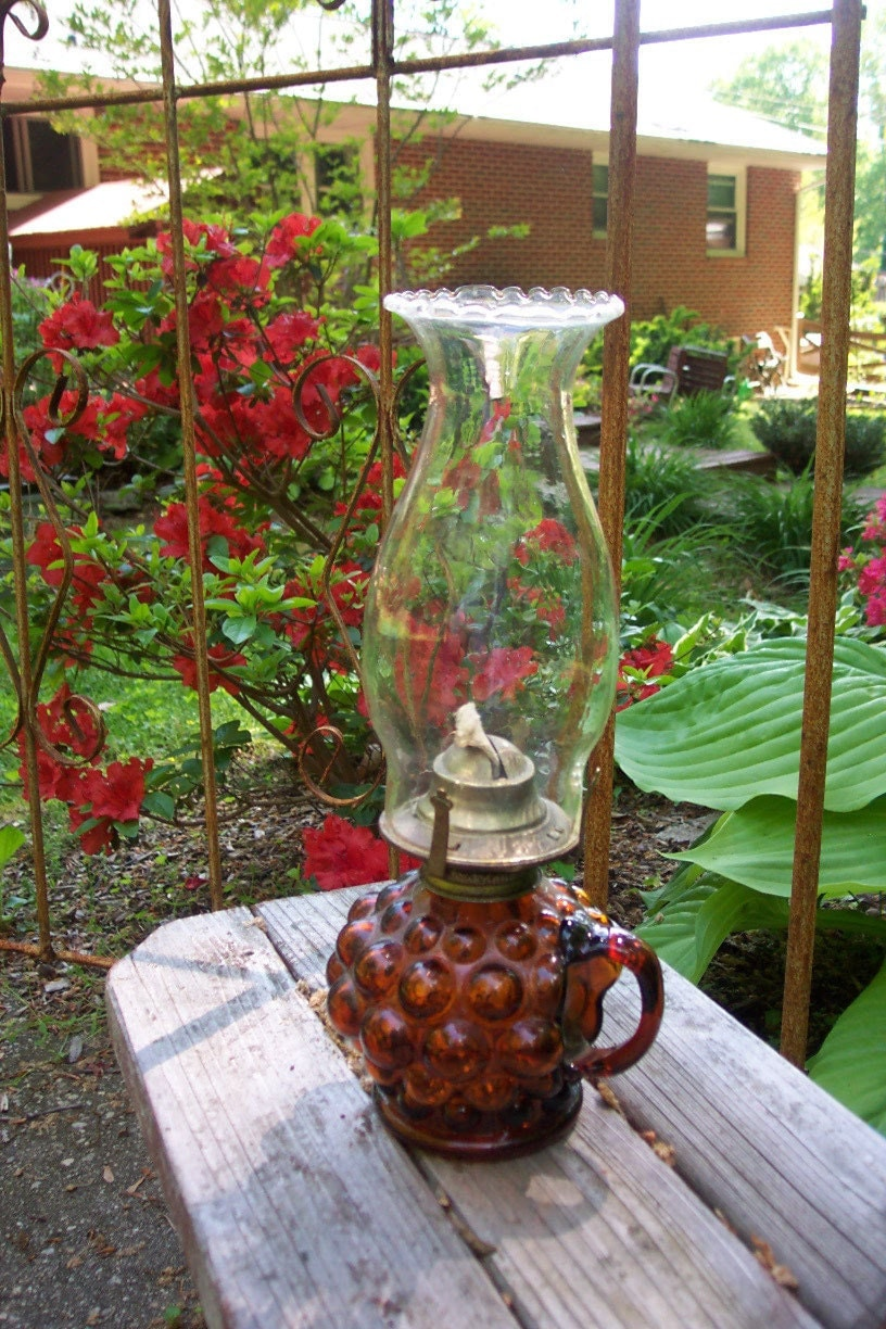 Vintage amber glass kerosene lamp