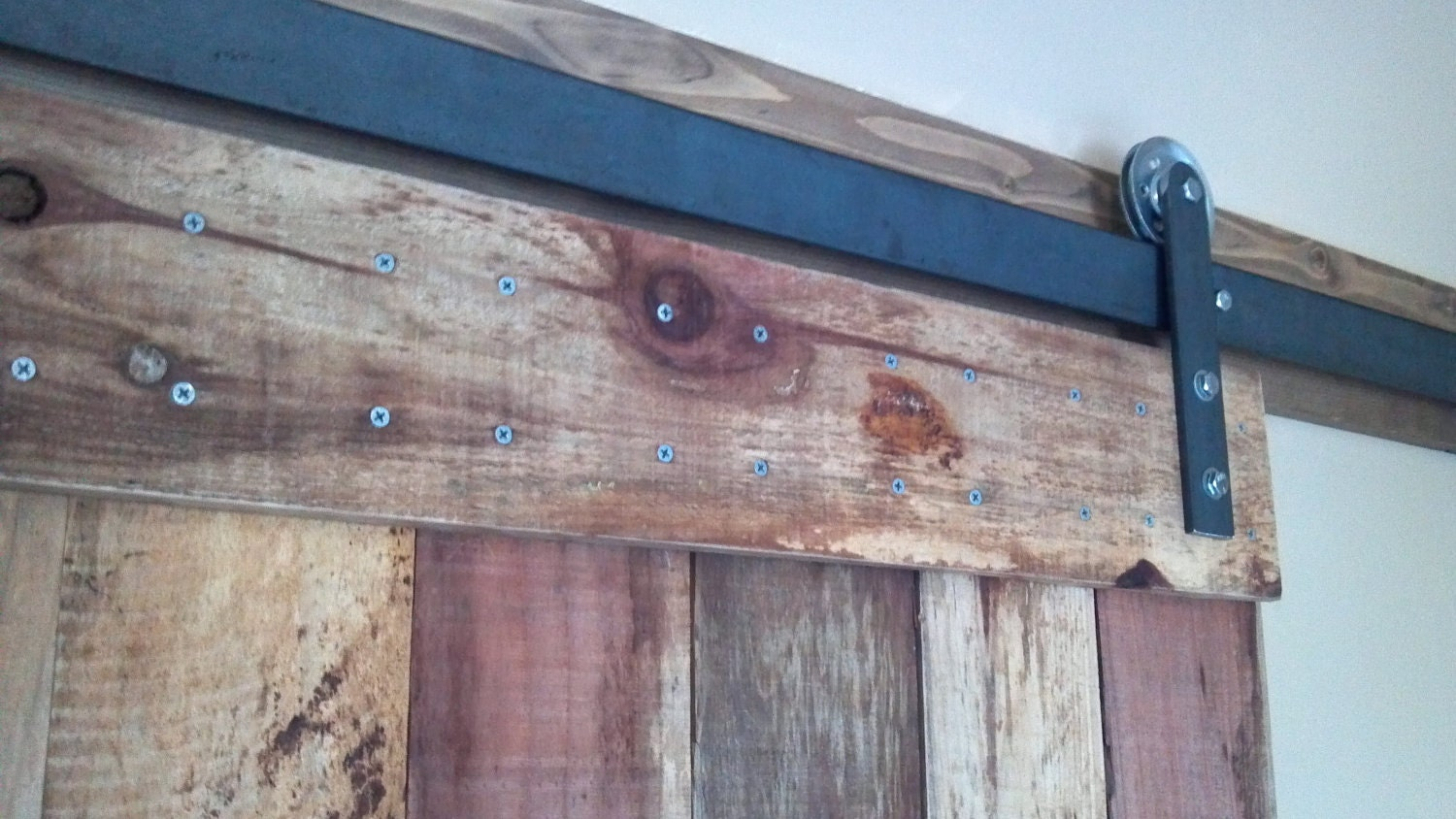 Similar to sliding barn door and complete steel track kit on etsy