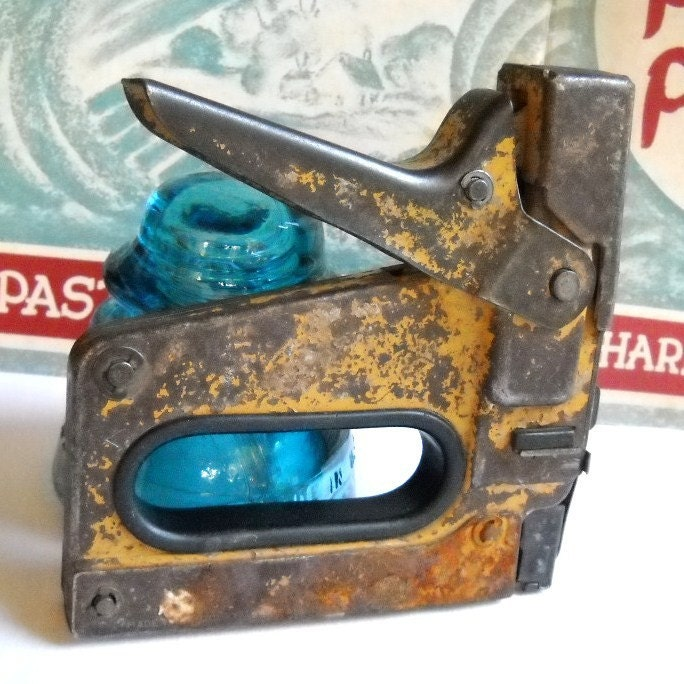 staple gun. stapler. tools. vintage