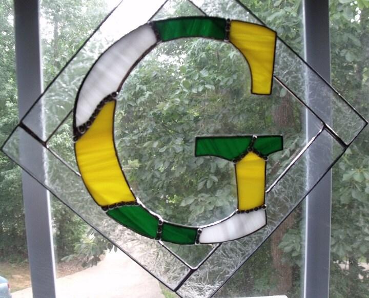 Decorative letter hanging initials letter g