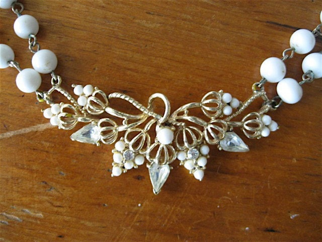 Vintage White Glass Bead Necklace with Stunning Rhinestone Flower Cluster Centerpiece Pendant.