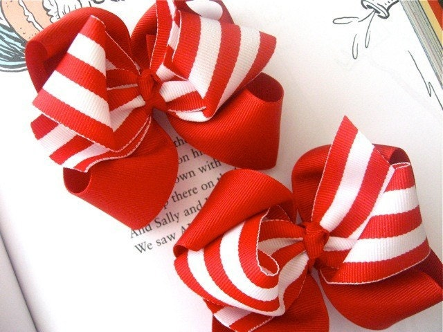 Pair of layered red and white striped candy cane hair bows