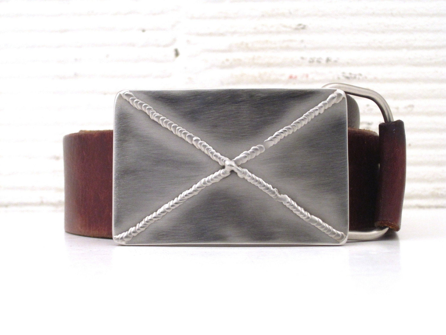 X marks the spot tig welded stainless belt buckle