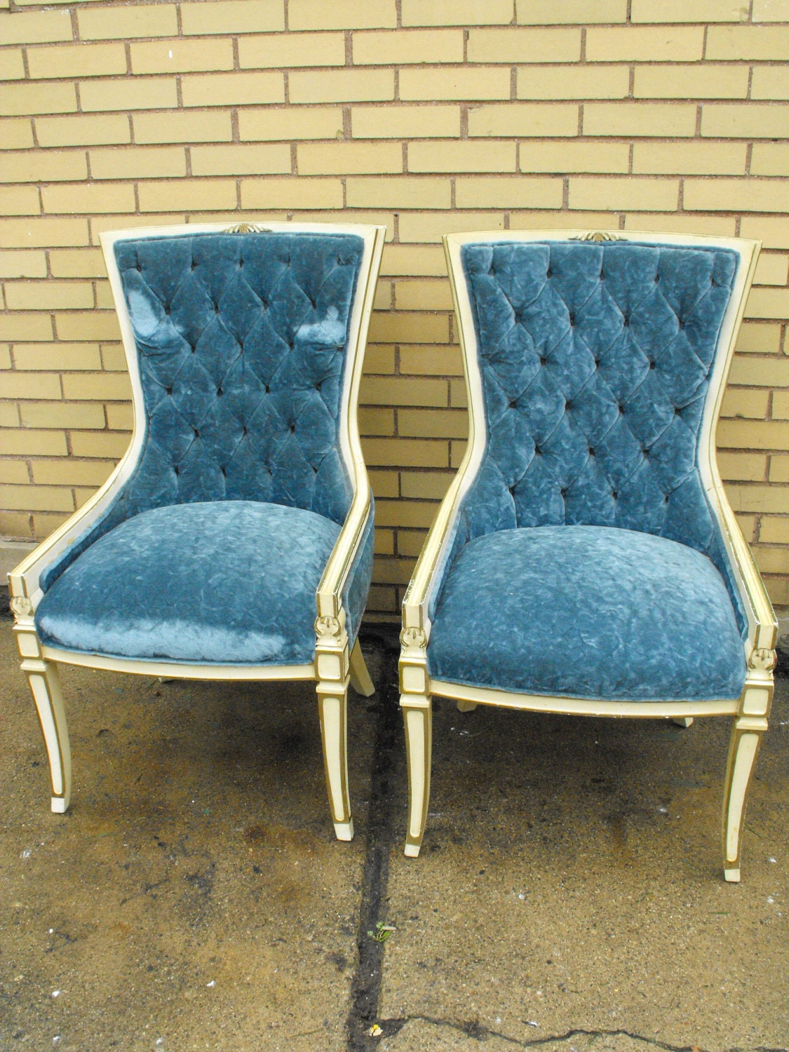 Two vintage antique tufted accent chairs by
