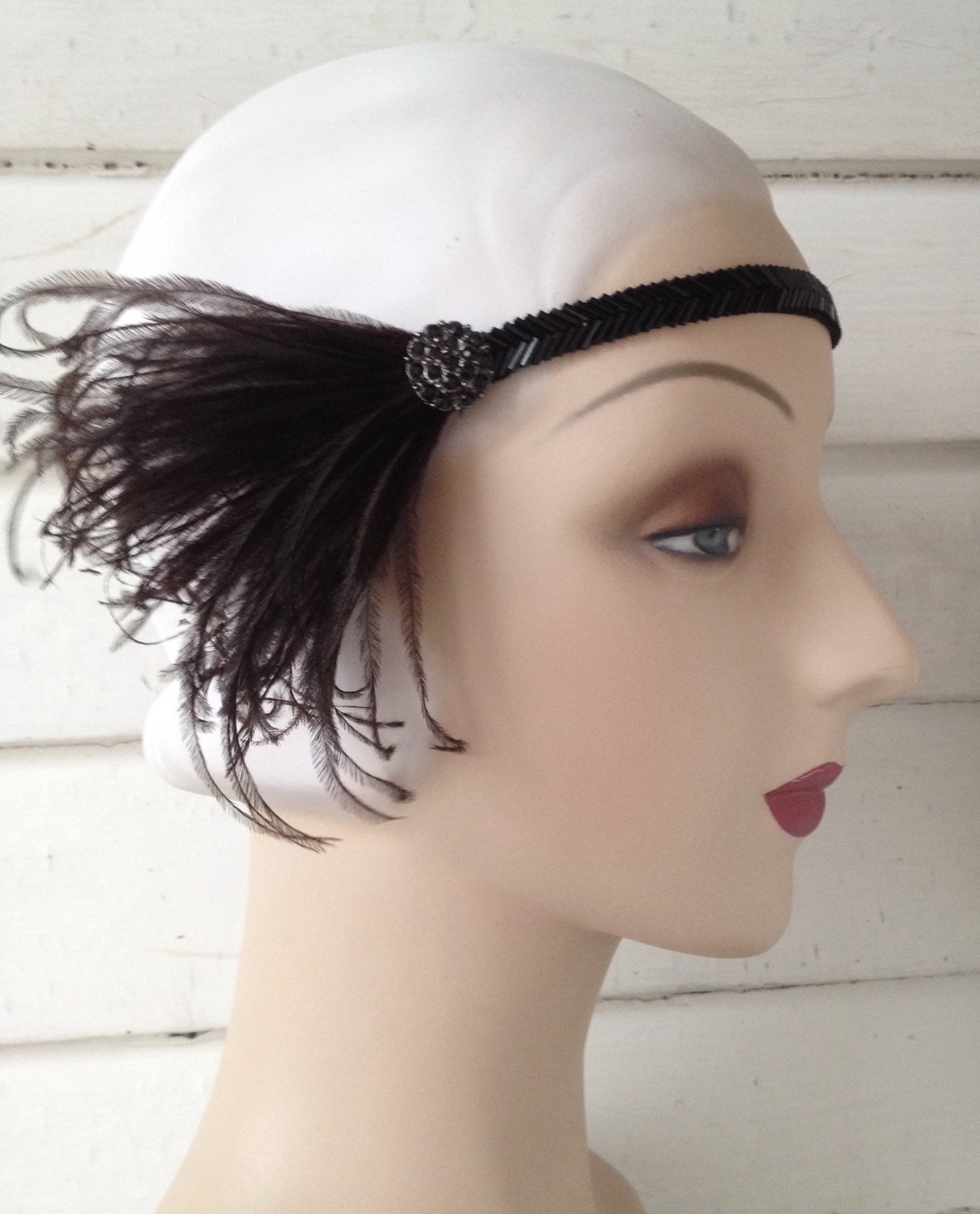 black silver or gold 1920s beaded flapper headband with elastic back vintage style rhinestone button and black white or ivory feathers $37.00 AT vintagedancer.com