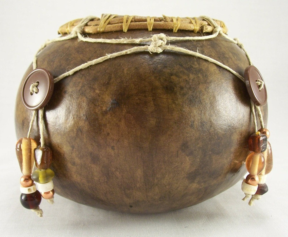 Brown gourd bowl with hemp, buttons, glass and metal beads netted decoration
