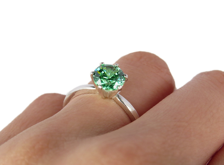 1 25 carat fancy light emerald green 7mm by tigergemstones