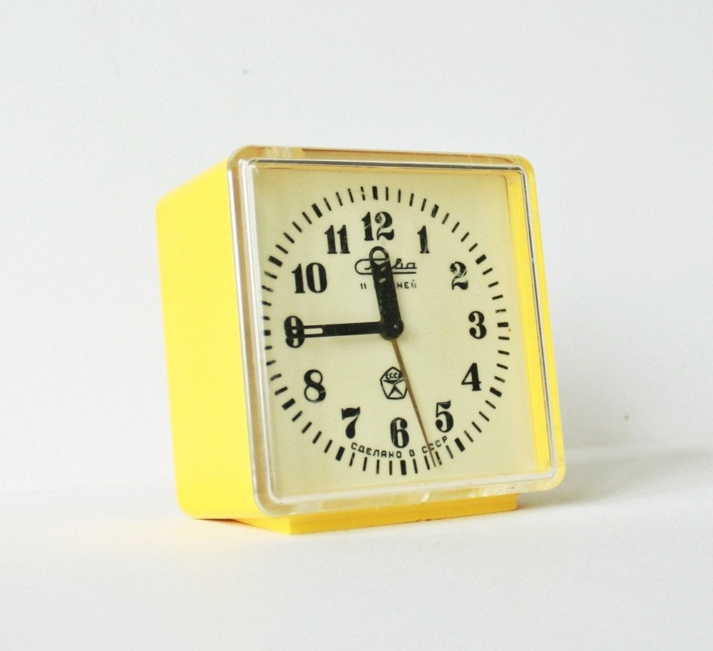 Vintage Russian mechanical alarm clock Slava from Soviet Union period