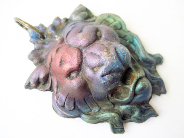 A Lion, a Star. Cosmic Cast Pendant with Faux Raku.