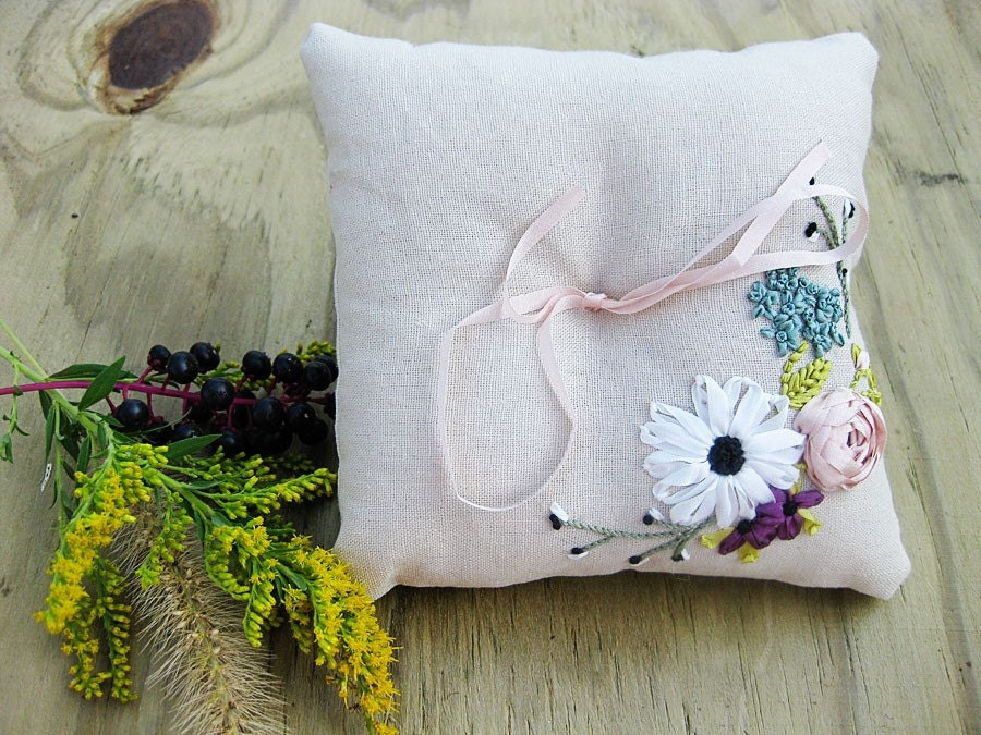 Ring pillow with ribbon embroidered flowers in pink and blue.