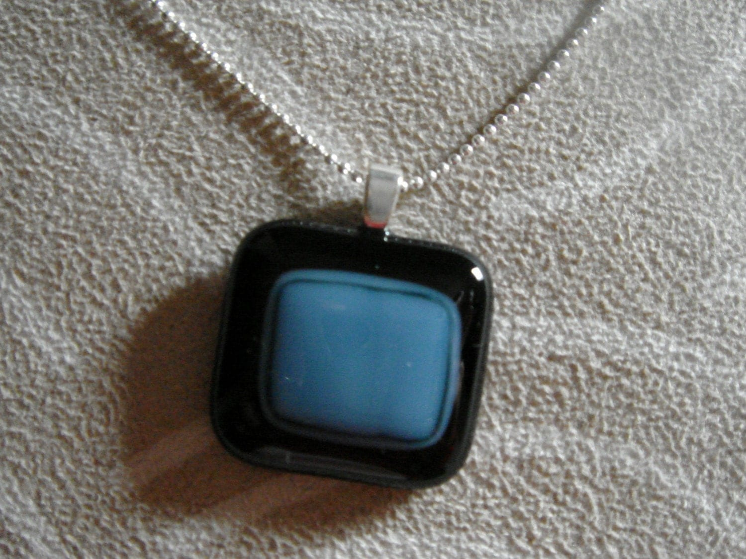 black n blue necklace