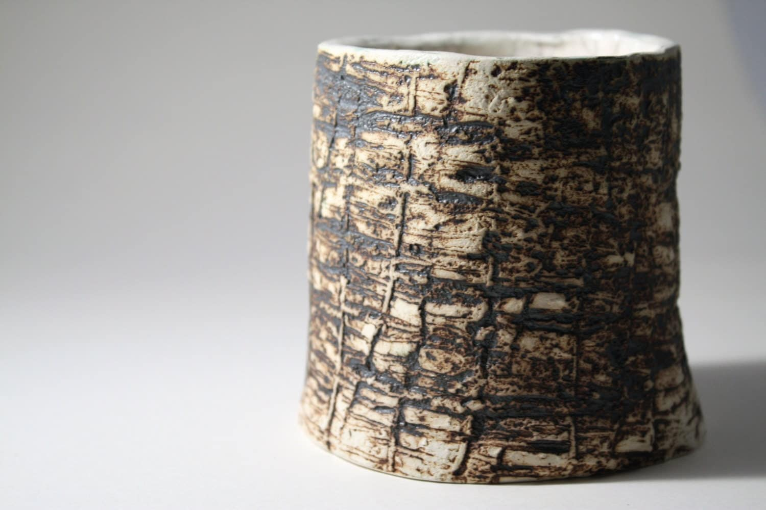 Hand built earthenware vessel with unique texture and aged look - madebymanos