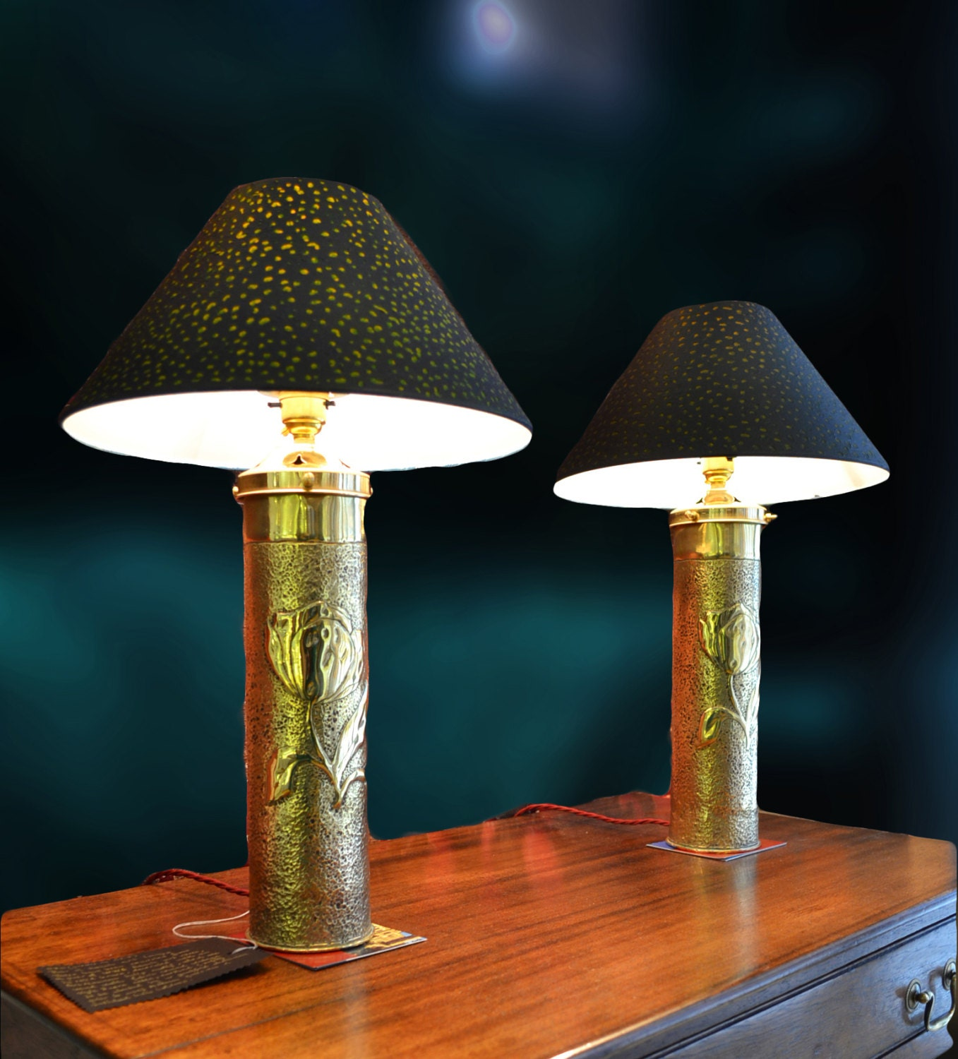 The Lacoona Shells  Pair of converted WWI Trench Art vases with Art Nouveau details with textured hand painted lamp shades