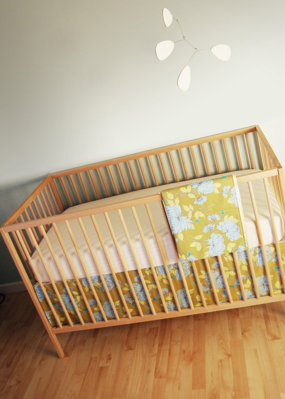 crib set. okra chrysanthemum. free giraffe with purchase.