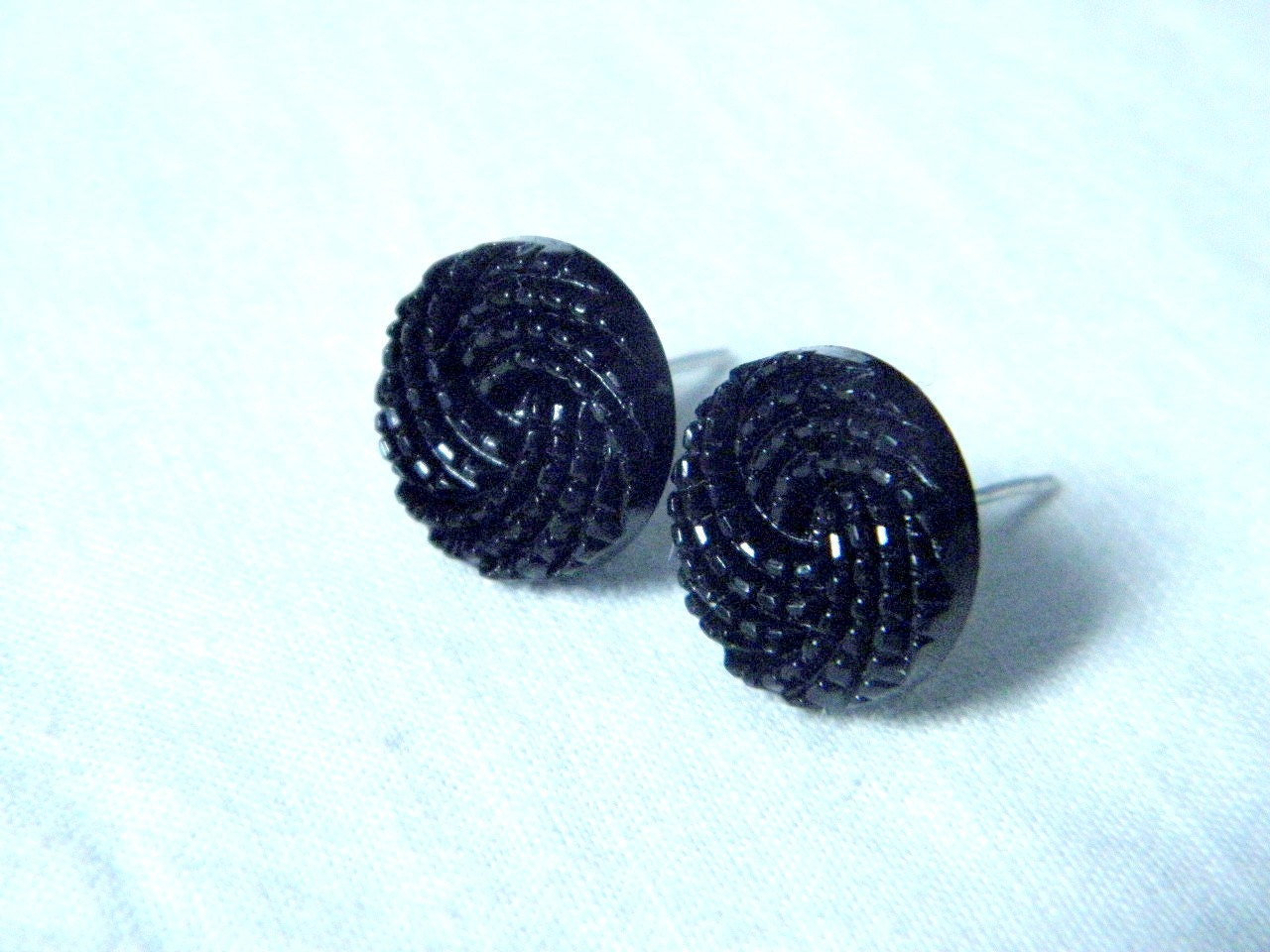 Plastic button earrings black color
