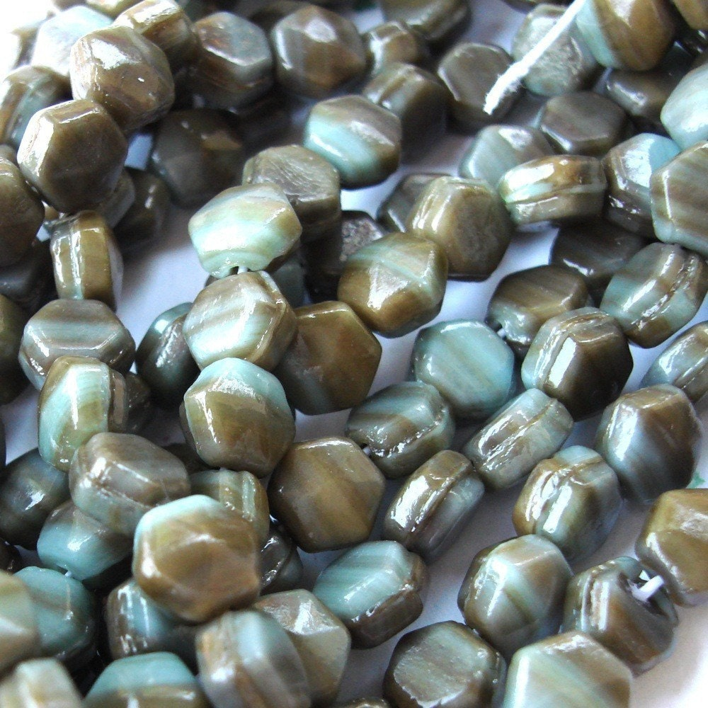 PALE TURQUOISE AND BROWN MUSHROOM NAILHEAD BEADS.   WAY BACK WHEN THE HEAD OF NAILS WERE SIX SIDED A BRILLIANT BEAD MAKER THOUGHT THAT NAILHEAD WAS A GOOD SHAPE FOR A BEAD.  5MM  (20) GB108