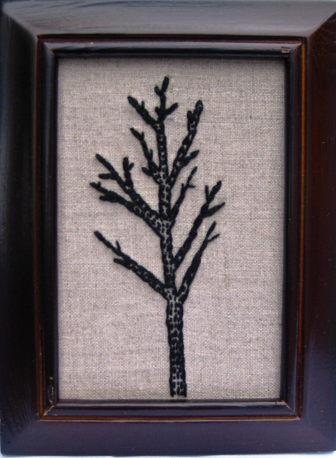 black embroidered tree