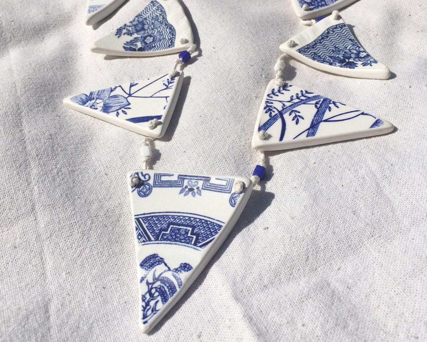 Tumbled china bunting  sea pottery finish  Blue  white