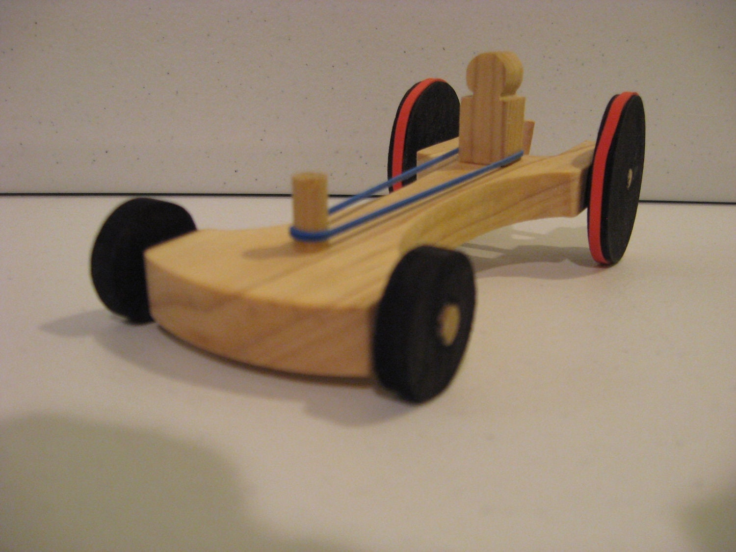 physics rubber band car Popsicle sticks work well for making the framework also, i have been using them in tiny model solar cars midwest products sells a kit of a rubberband powered car which will give you some ideas before designing your own.