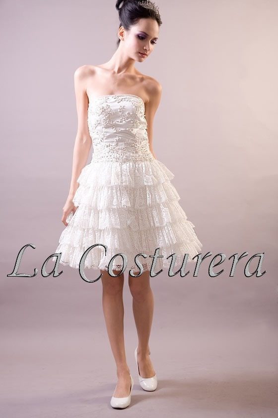there are also more youthful designs as the Pixie Short Wedding Dress
