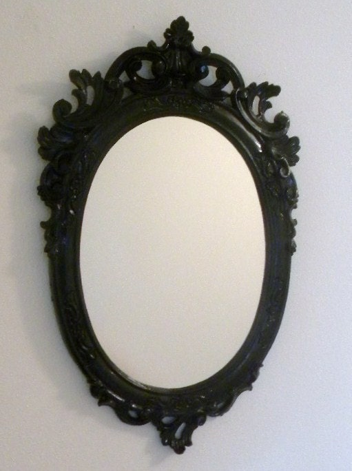 glossy up-cycled ornate Hollywood Regency mirror