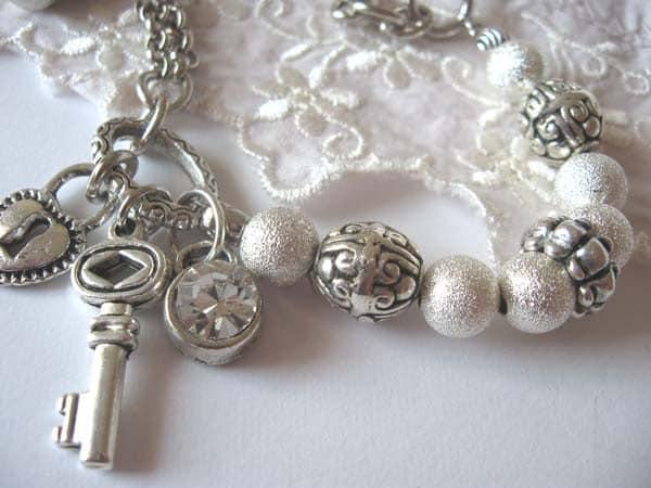 Glitter dust... a shimmering silver charm bracelet.