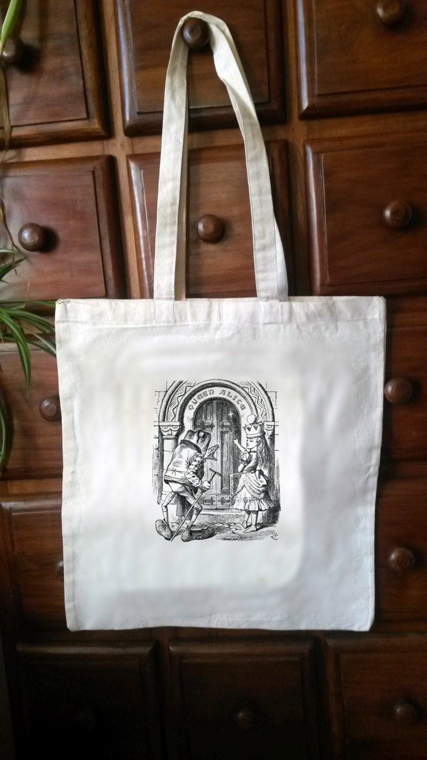 One CreamWhite Cotton Tote with an original illustration taken from the first edition of CS Lewiss Alice in Wonderland (Bag08)