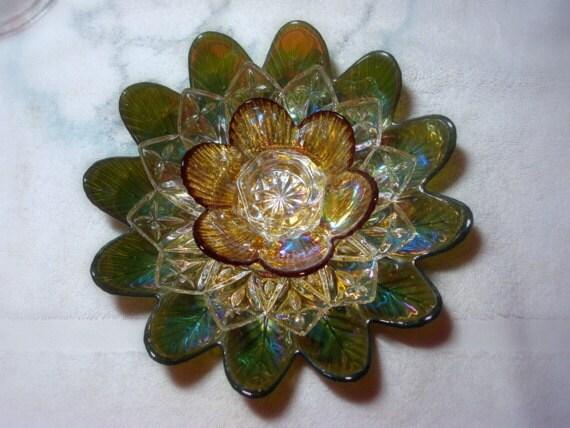 Garden art.  Glass flower.  Glass flower suncatcher.  Candle holder.  Green flower is made with repurposed glass.