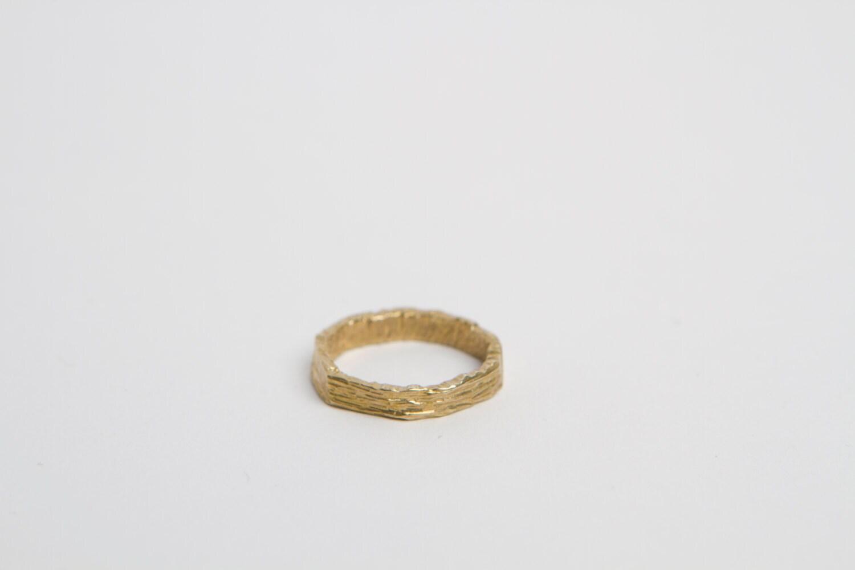 middle finger ring carved brass white