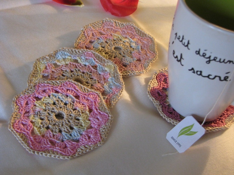 Set of four coasters in a combination of soft spring colors, beige, pink, wine red...