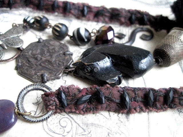 We Are His Sleep. Antique Feather Assemblage Neckpiece.