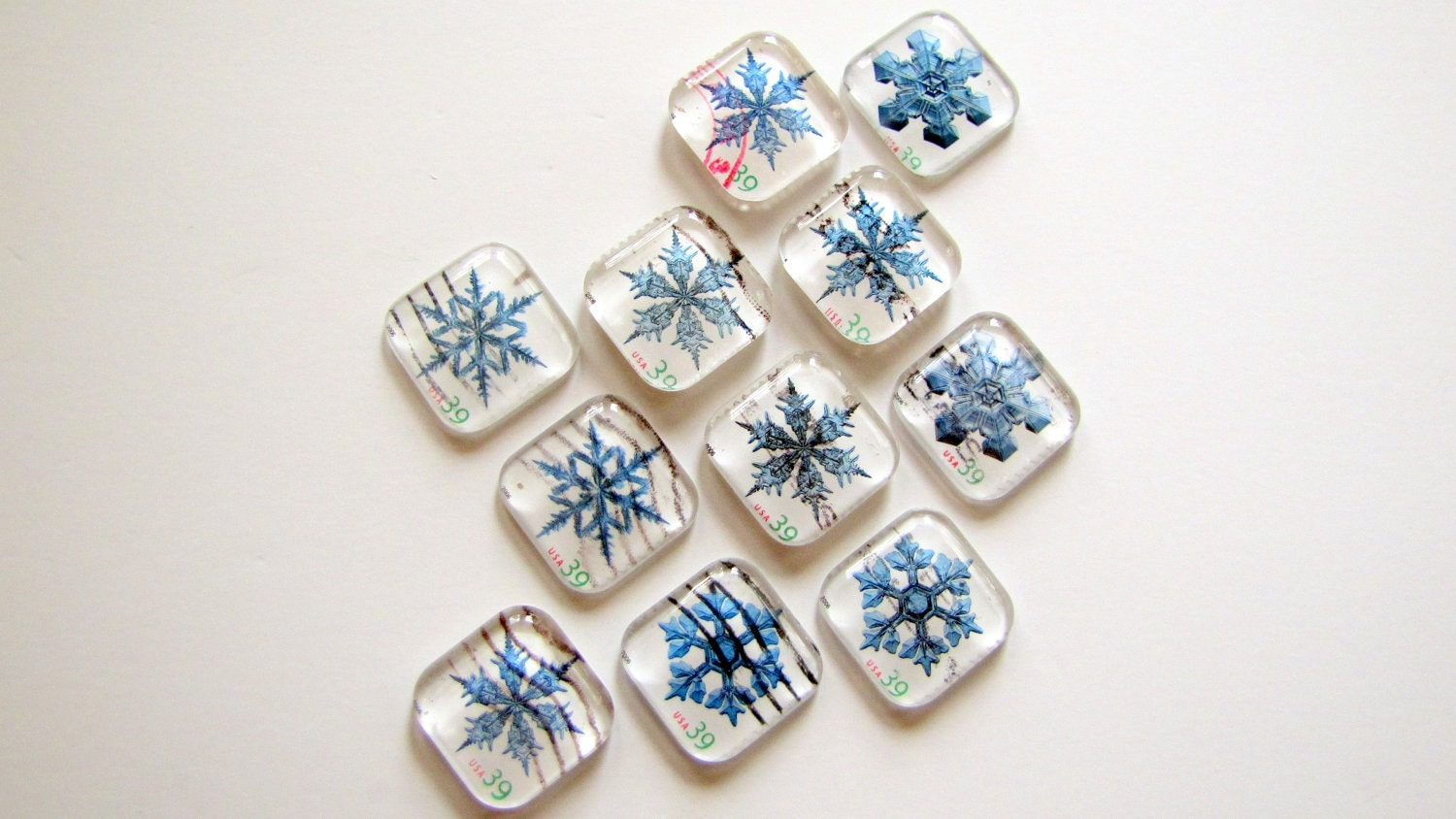 Snowflake recycled postage stamp magnets - set of 4