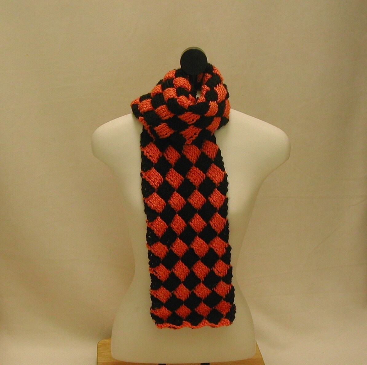 Orange and black entrelac scarf