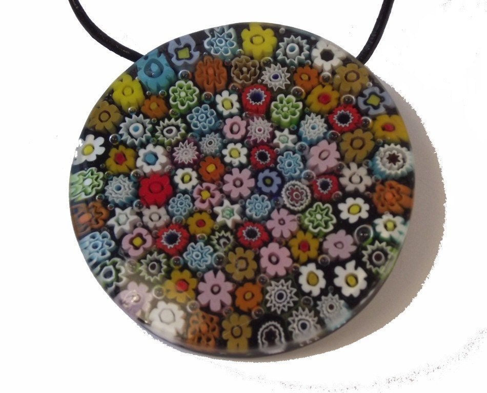 This large millefiori pendant is wonderfully detailed. It has a large sterling silver bail on the back.